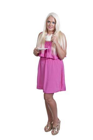 blonde minority: Beautiful young woman drinking coffee or tea Stock Photo