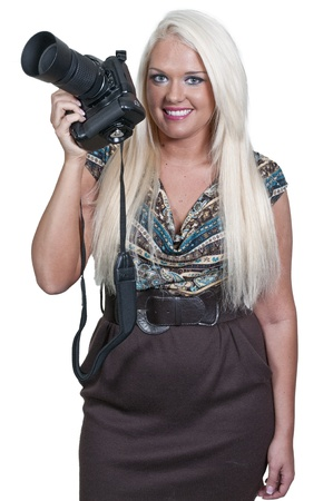 Beautiful woman professional photographer holding a dslr photo