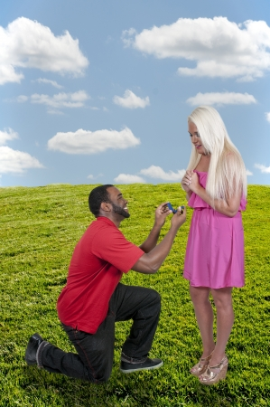 Man with a wedding ring proposing marriage to a woman photo