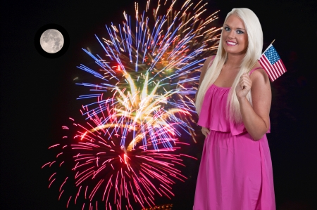 Young woman at a fourth of July firworks display photo