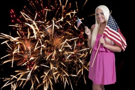 Beautiful woman holding a US flag at a fireworks display Stock Photo - 14879976