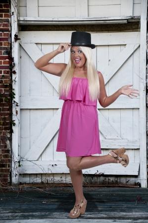 A beautiful young actress dancer wearing a top hat photo