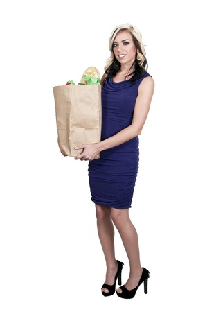 blonde minority: Beautiful young woman with a brown paper shopping bag