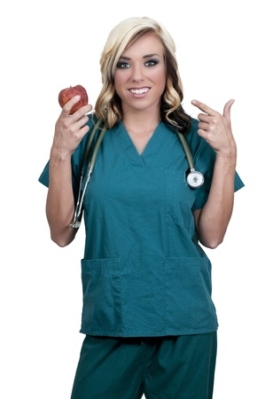 Female cardiologist holding a delicious red apple photo