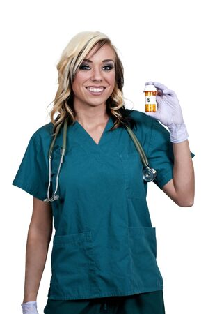 lpn: A beautiful young female doctor on her rounds holding a prescription bottle of medicine pills Stock Photo