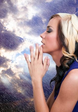 Beautiful Christian woman in a deep prayer Standard-Bild