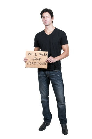 impoverished: Handsome man holding a sign that says will work for healthcare