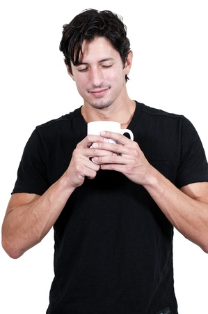 Young handsome man drinking coffee in the morning