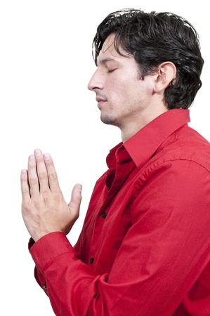 Handsome Christian man in a deep prayer photo