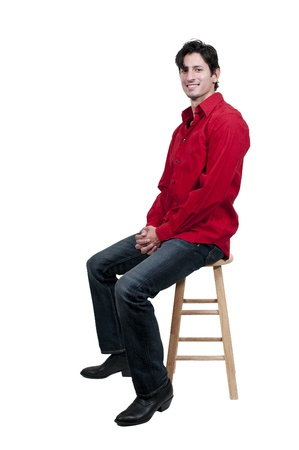 stool: An attractive handsome American or European young man Stock Photo