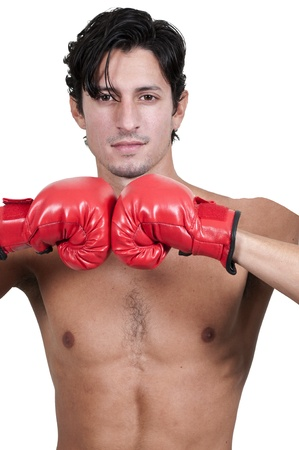 Attractive man athletic boxer in a fighting stance photo
