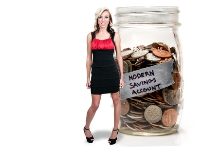 stilletto: Beautiful woman standing beside her retirement account of coins in a jar