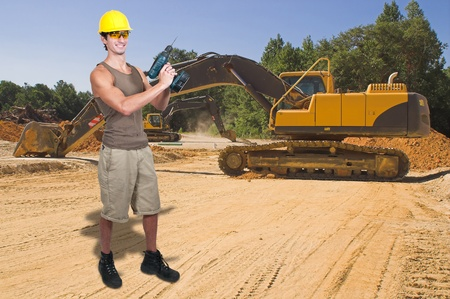 back hoe: A man Construction Worker on a job site.