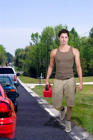 Handsome man with gas can out of gas Stock Photo - 14878796