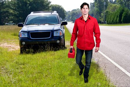 gas can: Handsome man with gas can out of gas Stock Photo