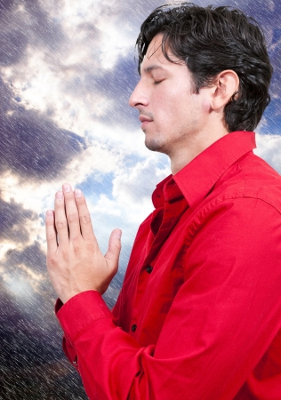 Handsome Christian man in a deep prayer Stock Photo - 14879949