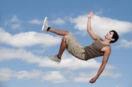 man flying: Handsome young man falling through the sky