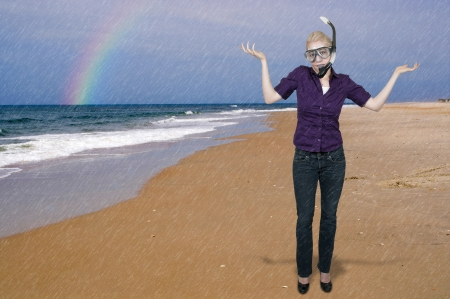snorkle: Woman in clothes in water with a snorkle and mask