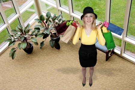 A beautiful young woman on a shopping spree photo