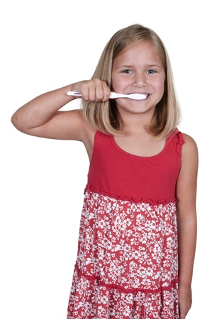 Beautiful little girl exercising good dental hygiene by brushing his teeth photo