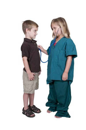 prodigy: Little girl doctor examining a patient