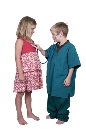 Little boy doctor examining a patient Stock Photo - 14880496