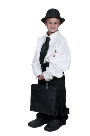 Little boy dressed in oversized suit clothes photo