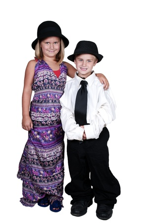 Little boy and girl dressed in oversized suit clothes photo
