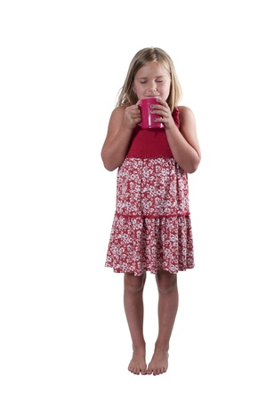 Beautiful young girl drinking and smelling hot chocolate Banco de Imagens