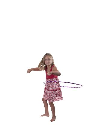 Beautiful little girl with a hula hoop photo