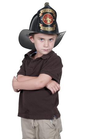 Little boy pretending to be a firefighter photo