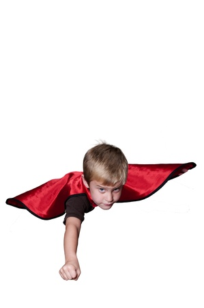 Handsome young boy super hero flying through the sky photo
