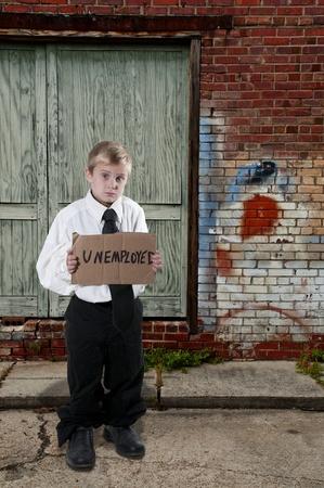 失業率看板を保持しているハンサムな男の子 写真素材