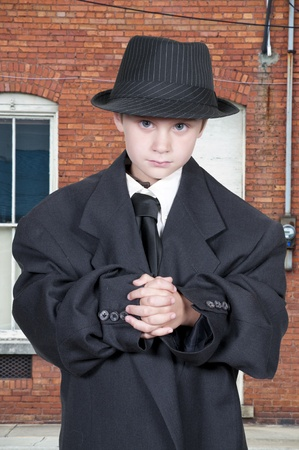 oversized: Little boy dressed in oversized suit clothes