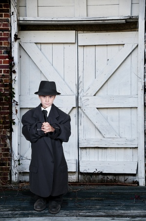 mafioso: Little boy dressed in oversized suit clothes