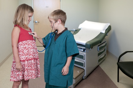 Little boy doctor examining a patient