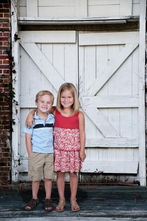 Little boy and little girl best friends photo
