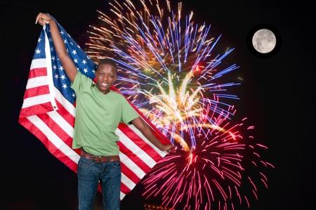 teenaged: Handsome young teenaged black man at a fireworks display