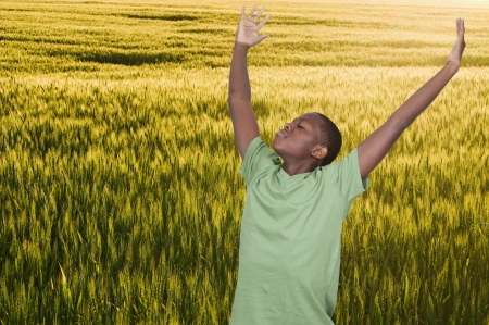 Handsome young African American teenager with allergies in a field Stock Photo - 15112979