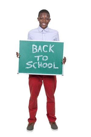 Teen Boy holding a chalkboard that says back to school 版權商用圖片 - 15113277