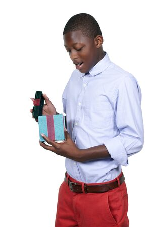 boxing day sale: Handsome man holding a Christmas gift present