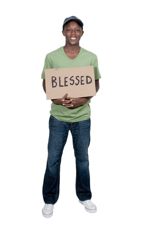 Handsome young man holding up a sign that says Blessed Imagens