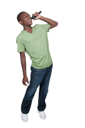 child singing: Young teenage black African American boy singer performing at a concert Stock Photo