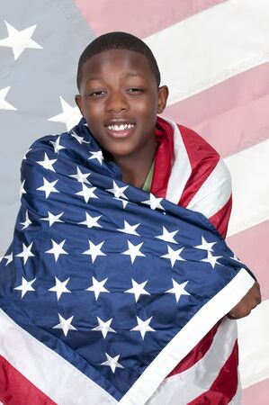 Handsome young teenaged black with the American flag photo