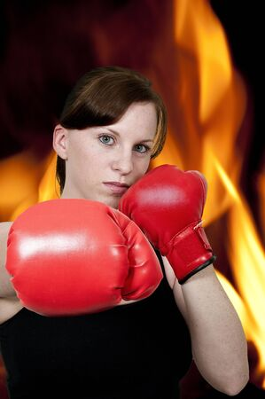 A beautiful young woman wearing a pair of boxing gloves Stock Photo - 15112831