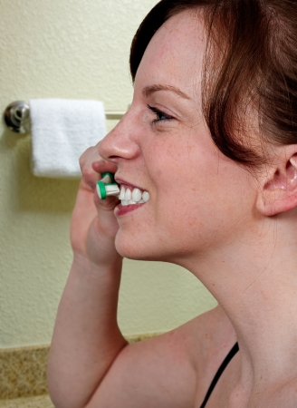 Beautiful woman practicing good oral dental care by brushing her teeth Stock Photo - 15113004