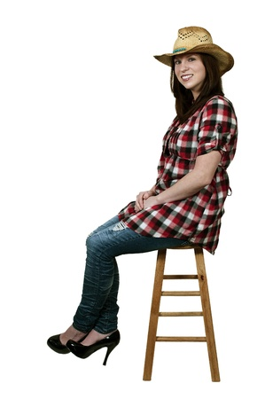 Beautiful young country girl woman wearing a stylish cowboy hat photo
