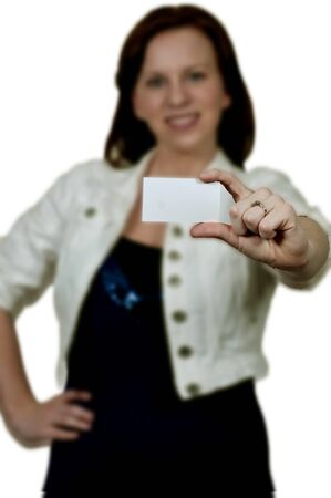 Beautiful young woman holding up a business card Stock Photo - 15113304