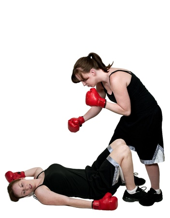 Beautiful young unconcious knocked out woman boxer with gloves photo