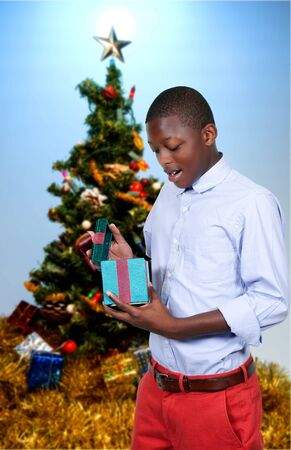 Handsome man holding a Christmas gift present photo
